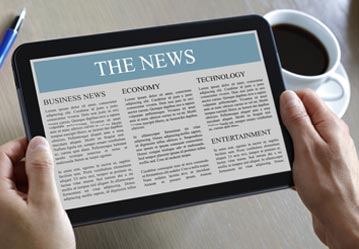 Closed-up of tablet displaying news
