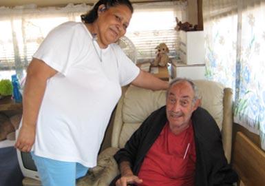 Caretaking woman and elderly man
